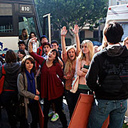Students boarding a bus to the portfolio show