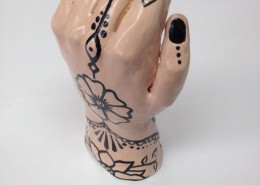 10, Henna Hand, This is project based on observational art/sculpture. I sculpted the hand our of white cone 5 clay on a banding wheel, using my own hand as a model. After the hand was bisque fired, I painted the henna design with low fire 06 glaze.